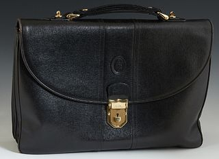 Marc Cross Black Leather Briefcase, the gold tone push lock opening to a suede and woven silk lined interior, with one center zipper...