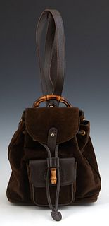 Vintage Gucci Chocolate Suede Mini Backpack, with gold-tone hardware, the peg hole and leather drawstring closure opening to a tan w...