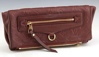 Louis Vuitton Bordeaux Empreinte Leather Sevigne PM Bag, the burgundy leather with embossed Louis Vuitton monogram with gold tone ha...