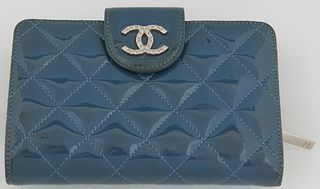 Chanel Blue Patent Leather Wallet, with silver tone button snap opening a blue leather interior with ten card holders and four bill...