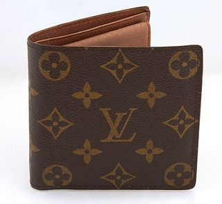 Louis Vuitton Marco Wallet, in brown and tan coated canvas monogram, with dual bill compartments, four card slots and a single inter...