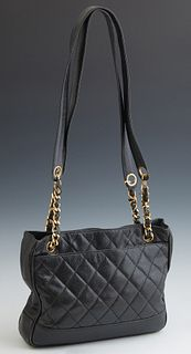 Vintage Chanel Black Caviar Shoulder Bag, with two gold tone snap button opening to a black leather lined interior with dual zip clo...