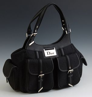 Christian Dior Medium Detective Black Monogram Canvas Bag, with silver hardware, the magnetic snap button closure opening to a lined...