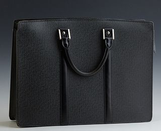 Louis Vuitton Black Taiga Leather Briefcase, with dual open compartments and a center silver toned zipper closure opening to a black...