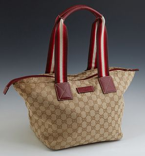 Gucci Beige Ivory Red Zipper Shoulder Bag, the red zipper closure opening to a brown woven interior with a side zip pocket and one o...