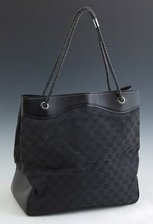 Gucci Black Monogram Canvas Tote Bag, the leather lined top opening to a woven interior with a zipper closure side pocket and leathe...