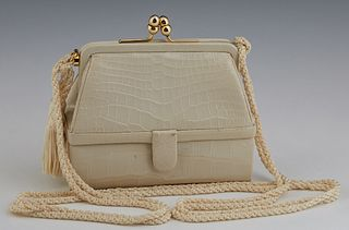 Vintage Judith Leiber 007 Ivory Crocodile Evening Bag, late 20th c., with a gold tone acorn kiss clasp opening to a ivory calf skin...