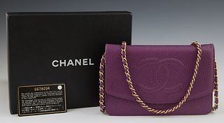 Chanel Purple Caviar Leather Wallet Purse, c. 2000, with a gold tone chain strap, the Chanel monogrammed snap flap opening to a purp...