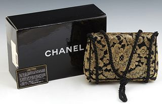 Chanel Black and Gold Brocade Evening Bag, c. 1990, the single flap snap button closure opening to a black satin and leather lined i...