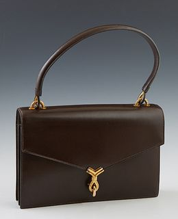 Vintage Hermes Brown Calf Leather Handbag, c. 1960, for Bonwit Teller, with a V flap closure and gold tone hardware latch, opening t...