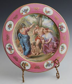 "Porcelain Cabinet Plate, ""Hercules on Forket Road,"" 20th c., marked verso ""Royal Vienna,"" and ""Made in Germany,"" The gilt rim around a wide pink band"