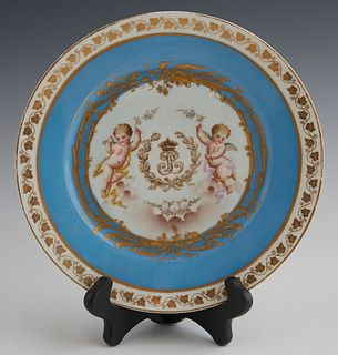"French Sevres Style Cabinet Plate, 19th c., with gilt and putti decoration, around an ""LP"" monogram, with a gilt leaf border around a heavenly blue ba"