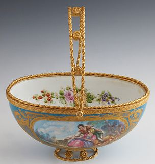 Sevres Gilt Bronze Mounted Porcelain Basket, 19th c., in Celestial Blue, one side with a reserve of lovers in a garden, signed Aurele, the interior wi