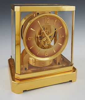 Jaeger LeCoultre Brass and Glass Atmos Clock, Ser. # 34294, c.1960, H.- 9 3/8 in., W.- 8 1/4 in., D.- 6 1/4 in. Provenance: from a collection of an an