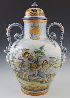 Large French Provincial Style Style Footed Faience Covered Jar, 19th c., of tapered baluster form, the sides with applied snake handles, over a floral