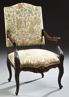 French Louis XV Style Carved Walnut Fauteuil, 19th c., the arched canted upholstered high back over well carved floral and leaf arms to an upholstered