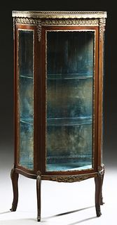 French Louis XV Style Ormolu Mounted Carved Mahogany Marble Top Vitrine, late 19th c., the brass bound brown marble top with a pierced 3/4 brass galle