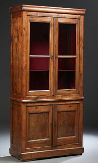 French Louis Philippe Carved Cherry Bookcase Cupboard, 19th c., the rounded crown over double glazed doors, atop a base with two cupboard doors, on a