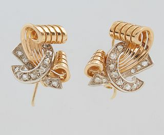 "Pair of 18K Yellow Gold Art Deco Style Pierced Earrings, the swirled gold scroll bisected by a round diamond mounted ""C"" shape ribbon, H.- 3/4 in., W."