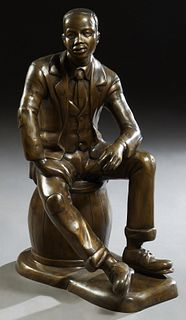 """""""The Storyteller,"""" 21st c., depicting an Afro American man sitting on a keg, on an integral shaped rectangular base, H.- 36 in., W.- 16 in., D.- 25 in"""