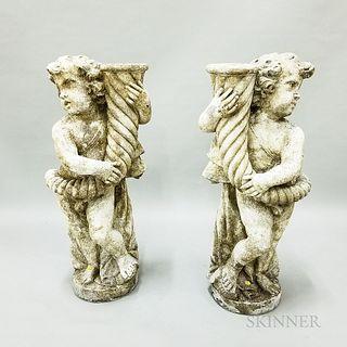 Two Cast Concrete Putti Garden Sculptures