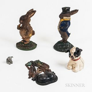 Two Polychrome Cast Iron Rabbit Doorstops, a Dog Bank, a Game Match Safe, and a Small Dog