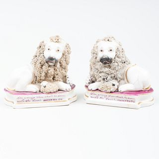 Pair of Staffordshire 'Lion and Lamb' Figures