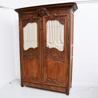 Nice French antique carved walnut armoire
