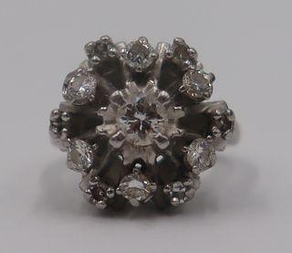 JEWELRY. Platinum and Diamond Cluster Ring.