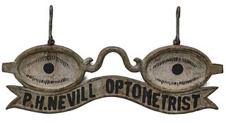 AN EARLY 20TH CENTURY HANGING OPTOMETRIST'S TRADE SIGN