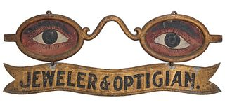 A CLASSIC PAINTED IRON AND ZINC OPTICIAN'S TRADE SIGN