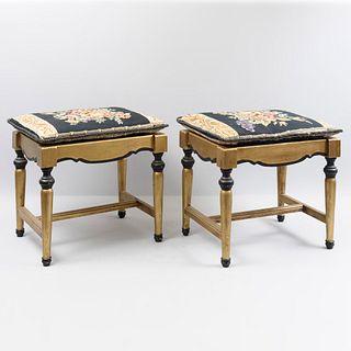 Par de bancos. Siglo XX. En talla de madera. Acabado dorado. Con cojines en petit point. Con asientos acojinados.