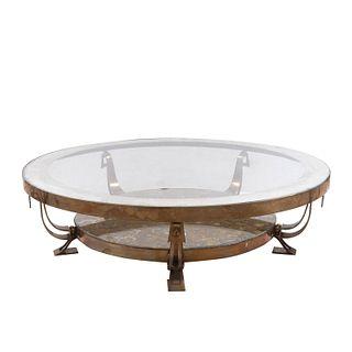 Mesa de centro. Siglo XX. Estilo Arturo Pani. Elaborada en metal dorado. Con cubierta circular superior de vidrio. 60 x 112 cm Ø