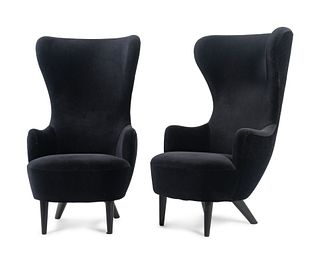 A Pair of Tom Dixon Wingback Chairs Height 50 x width 27 1/2 inches.
