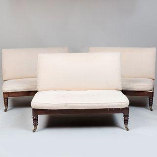 Three Edwardian Mahogany and Upholstered Settees