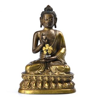 A Gilt Bronze Figure of Sakyamuni Buddha
