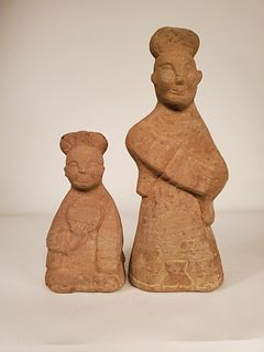 Two Eastern Han Dynasty carved stone smiling figures