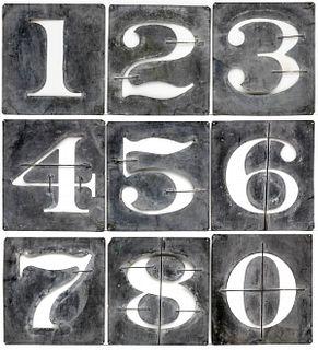 A SET OF LARGE 19TH CENTURY ZINC NUMERAL STENCILS