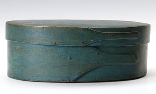A SHAKER QUALITY OVAL PANTRY BOX IN OLD BLUE PAINT