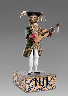 Ancient automaton with a monkey playing the guitar
