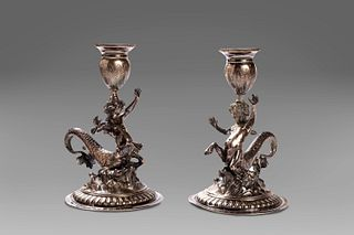 Pair of silver candle holders with young tritons, Genoa, early 19th century