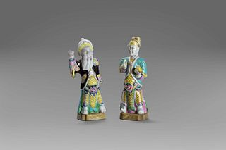 Two polychrome porcelain figurines depicting dignitaries, 18th century China