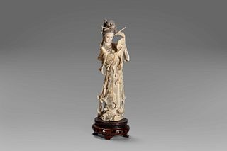 Ivory sculpture depicting a female figure with a mirror, China, early 20th century