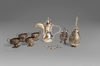 Lot consisting of seven silver objects: four small salt cellars, an Egyptian jug, a wick and a sugar spreader