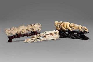 Lot of three ivory sculptures: a dragon, a shell with a female figure inside, an elephant with lion and monkey, early 20th century