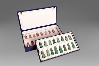 Sixteen chess pieces in jade and sixteen in rose quartz, in box, China, 20th century