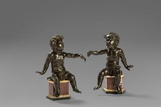 Pair of dark patina bronze putti, with non-coeval marble bases, Rome 17th century