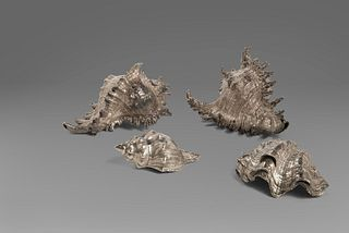 Lot of four shells covered in silver, the smallest signed Federico Buccellati