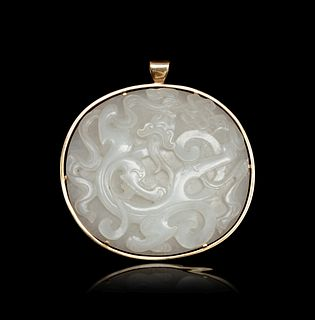 A Carved White Jade 'Chilong' Plaque Length 3 in., 7.6 cm.