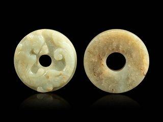 Two Celadon Jade Bi Disks Diameter of larger 2 3/8 in., 6 cm.